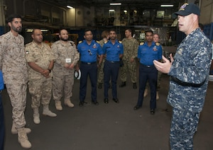 Lt. Mick Kalman discusses the capabilities of Afloat Forward Staging Base (Interim) USS Ponce (AFSB(I)-15) with participants of the International Maritime Exercise (IMX) 2017. IMX is a command post exercise and includes more than 20 partner nations to promote interoperability, increase readiness in all facets of defensive maritime warfare and demonstrate resolve in maintaining regional security and stability and protecting the free flow of commerce. (U.S. Navy photo by Mass Communication Specialist 1st Class Grant P. Ammon)