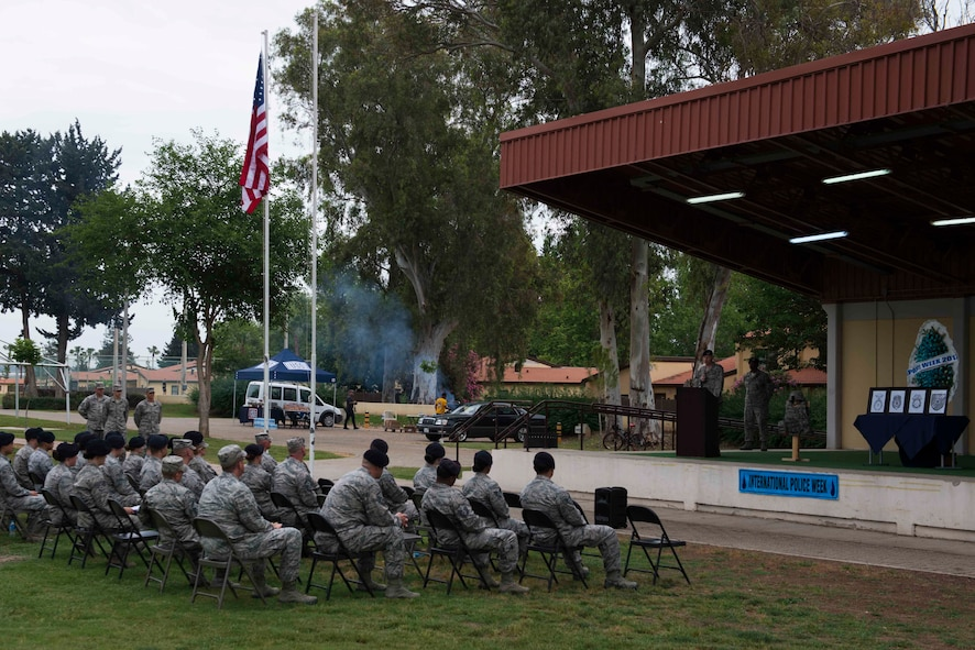 Airmen assigned to the 39th Air Base Wing attend the Incirlik Police Week 2017 closing ceremony May 18, 2017, at Incirlik Air Base, Turkey. National Police Week began in 1962 after President John F. Kennedy signed a proclamation designating May 15 as Peace Officers Memorial Day and the week in which that date falls as Police Week. (U.S. Air Force photo by Airman 1st Class Devin M. Rumbaugh)