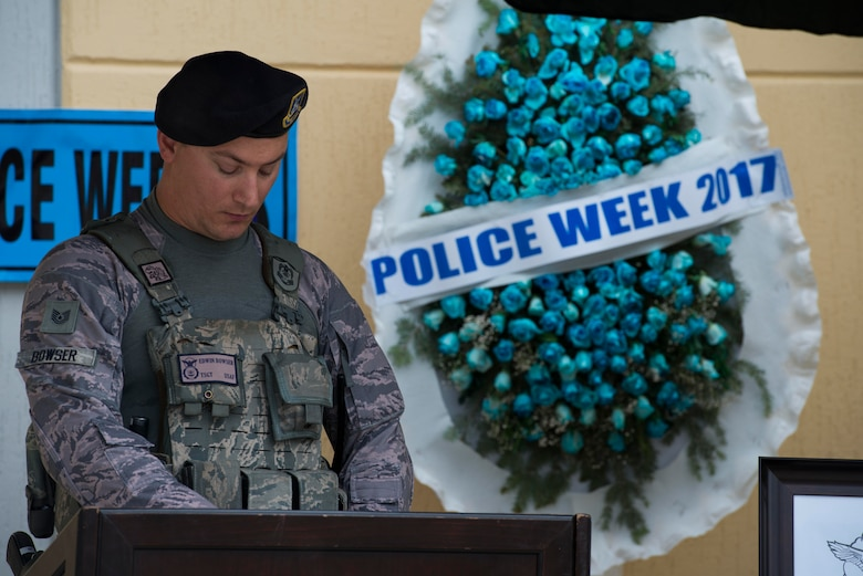 U.S. Air Force Tech. Sgt. Edwin Bowser, 39th Security Forces Squadron flight chief, reads the names of fallen police officers during a memorial vigil May 18, 2017, at Incirlik Air Base, Turkey. National Police Week began in 1962 after President John F. Kennedy signed a proclamation designating May 15 as Peace Officers Memorial Day and the week in which that date falls as Police Week. (U.S. Air Force photo by Airman 1st Class Devin M. Rumbaugh)