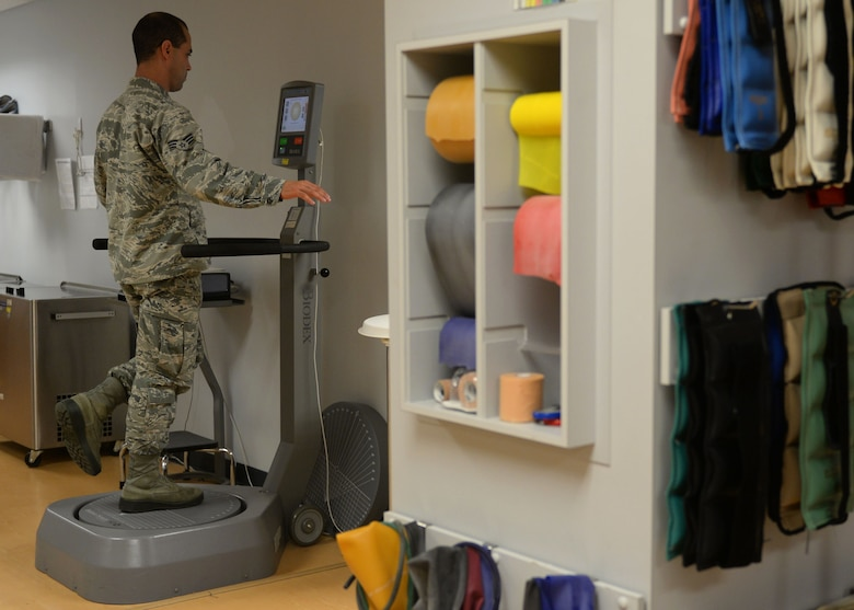 Senior Airman Hessen Martinez Cruz, 19th Medical Operations Squadron physical therapy technician, demonstrates one of the many machines the clinic offers to help rehabilitate Airmen May 2, 2017 at the physical therapy clinic on Little Rock Air Force Base, Arkansas. From identifying problems to developing and implementing a care plan, physical therapy specialists like Martinez-Cruz work with patients as long as necessary so they can resume healthy, active lifestyles. (U.S. Air Force photo by Airman 1st Class Codie Collins)
