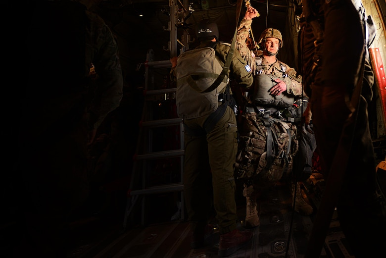 An Israeli Defense Force jump master looks over the rig of a U.S. Army Air Cavalry soldier attached to the 173rd Air Brigade from Vincenza, Italy , prior to an airdrop sortie in support of exercise Juniper Falcon May 15, at Nevatim Air Force Base, Israel. Juniper Falcon 17 represents the combination of several bi-lateral component exercises with Israel Defense Forces that have been executed annually since 2011. These exercises were combined to increase joint training opportunities and capitalize on transportation and cost efficiencies gained by aggregating forces. (U.S. Air Force photo/ Tech. Sgt. Matthew Plew)