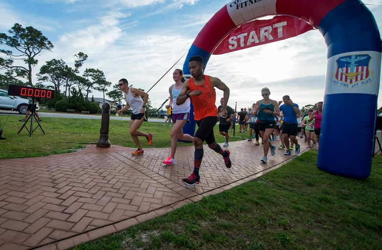 Participants take-off during the 2nd Annual Run to Honor event at Hurlburt Field, Fla., May 18, 2017. Air Force Special Operations Command Families Forever Program and the 1st Special Operations Force Support Squadron hosted the 2nd Annual Run to Remember 5k ruck, 5k and 10k. (U.S. Air Force photo by Senior Airman Krystal M. Garrett)