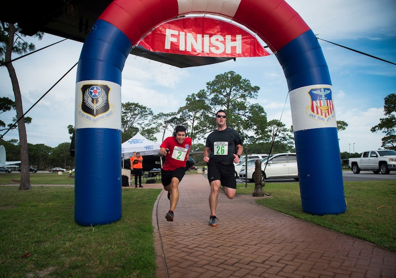 Runners race to the finish line during the 2nd Annual Run to Honor event at Hurlburt Field, Fla., May 18, 2017. Air Force Special Operations Command Families Forever Program and the 1st Special Operations Force Support Squadron hosted the 2nd Annual Run to Honor 5k ruck, 5k and 10k. (U.S. Air Force photo by Senior Airman Krystal M. Garrett)