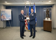 Maj. John Hourigan, a 123rd Operations Support Squadron C-130 Hercules pilot, receives the Koren Kolligian Jr. Trophy from Air Force Vice Chief of Staff Gen. Stephen Wilson at the Pentagon, Washington, D.C., May 17, 2017. During a training mission on July 15, 2016, Hourigan's aircraft began vibrating so loudly that crew members were unable to communicate with each other through their headsets, read gauges or flight instruments. Hourigan quickly determined the source of vibration, implemented corrective action and executed an engine-out landing, saving the lives of all six crew members on board. (U.S. Air National Guard photo by Master. Sgt. Marvin R. Preston)