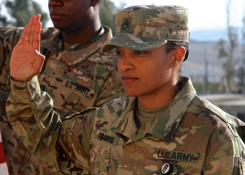 Staff Sgt. Christal Crawford, USARCENT broadcast specialist, takes the oath of enlistment, May 5, 2017, during exercise Eager Lion in Jordan.