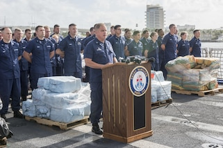 Capt. Scott Clendenin, the Coast Guard Cutter Hamilton commanding officer, speaks at a drug offload press event in Port Everglades, Fla., May 18, 2017. Joint operations lead to the interdiction of over 18.5 tons of contraband. Photo by Petty Officer 1st Class Luke Clayton