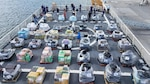 Media members get video of contraband during a drug offload press event in Port Everglades, Fla., May 18, 2017. Joint operations lead to the interdiction of over 18.5 tons of contraband. (Photo by Petty Officer 1st Class Luke Clayton)
