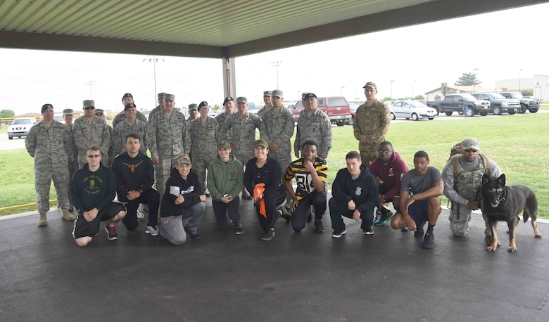 Members of the 22nd Security Forces Squadron pose for a photo with Col. Albert Miller, 22nd Air Refueling Wing commander, May 18, 2017, at McConnell Air Force Base, Kan. After completing a ruck march during Police Week, Staff Sgt. Natalie Whitt, 22nd Security Forces Squadron Armory NCO in charge, was recognized as the spotlight performer for the week of May 1-5. (U.S. Air Force photo/Airman 1st Class Erin McClellan)