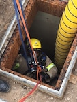 Los Angeles Fire Department crew member ascending into DFSP San Pedro Tank 15 during confined space and rescue training.