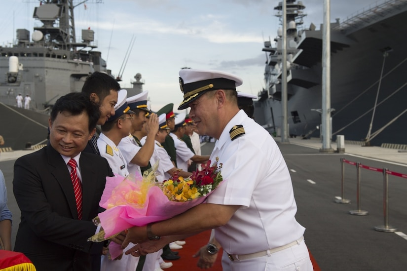 U.S. Navy Capt. Stanfield Chien, right, receives a welcoming gift from a Vietnamese government representative during the opening ceremony for Pacific Partnership 2017 in Cam Ranh, Khanh Hoa province, Vietnam, May 20, 2017. Navy photo by Petty Officer 2nd Class Chelsea Troy Milburn