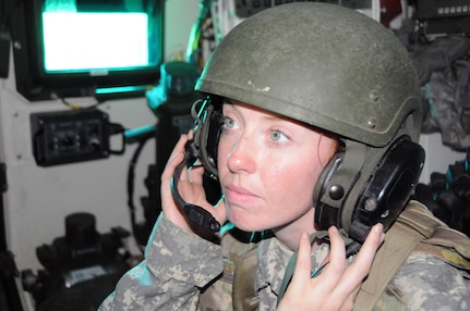 Spc. Allison Clevenger, a chemical, biological, radiological and nuclear specialist with the U.S. Army Reserve's 300th Chemical Company from Morgantown, West Virginia, watches a monitor in the back of a Stryker M1135 Nuclear, Biological and Chemical Reconnaissance Vehicle May 19 during .50 caliber live-fire qualifications at Joint Base McGuire-Dix-Lakehurst, New Jersey.  Clevenger serves as the crew's assistant surveyor.