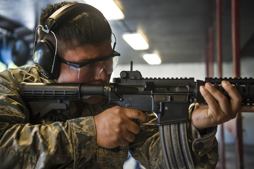 Staff Sgt. Mikhail Reyna-Maynez, 628th Communications Squadron cyber transport systems supervisor, fires his weapon during a competition at Joint Base Charleston, S.C., May 17, 2017. Several events, including a M4 carbine firing competition, were held in honor of Police Week.