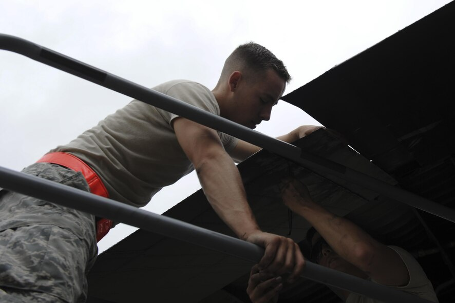 Airmen 1st Class Austin Luke, left, and Daniel Goerdt, crew chiefs with the 4th Aircraft Maintenance Unit, install a flat baffle onto the wing of an AC-130U Spooky gunship at Hurlburt Field, Fla., May 19, 2017. A flat baffle keeps turbulence to a minimum and aerodynamics to a maximum as the aircraft and its crew conduct special operations worldwide. (U.S. Air Force photo by Airman 1st Class Dennis Spain)