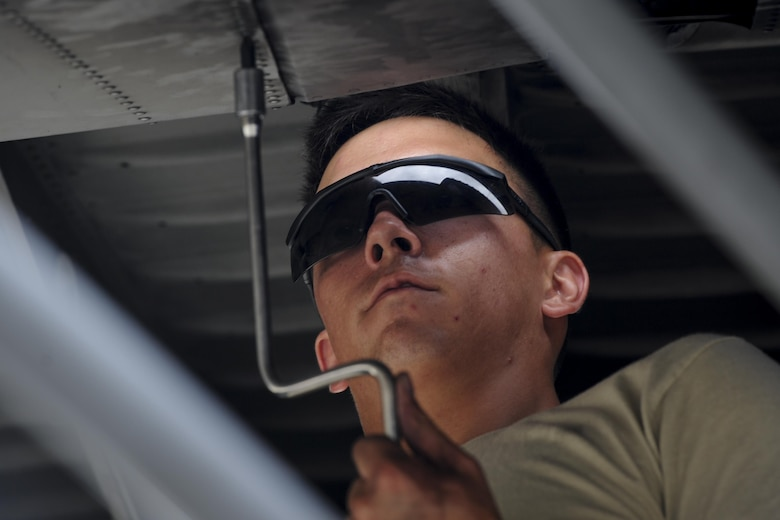 Airman 1st Class Daniel Goerdt, a crew chief with the 4th Aircraft Maintenance Unit, installs a flat baffle into the wing of an AC-130U Spooky gunship at Hurburt Field, Fla., May 19, 2017. Flat baffles are replaced on wings of aircraft to improve in-flight aerodynamics. (U.S. Air Force photo by Airman 1st Class Dennis Spain)