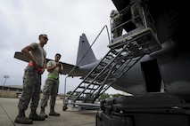 Air Commandos from the 4th Aircraft Maintenance Unit finish installing a flat baffle on an AC-130U Spooky gunship at Hurburt Field, Fla., May 19, 2017. Flat baffles are replaced on wings of aircraft to improve in-flight aerodynamics. (U.S. Air Force photo by Airman 1st Class Dennis Spain)