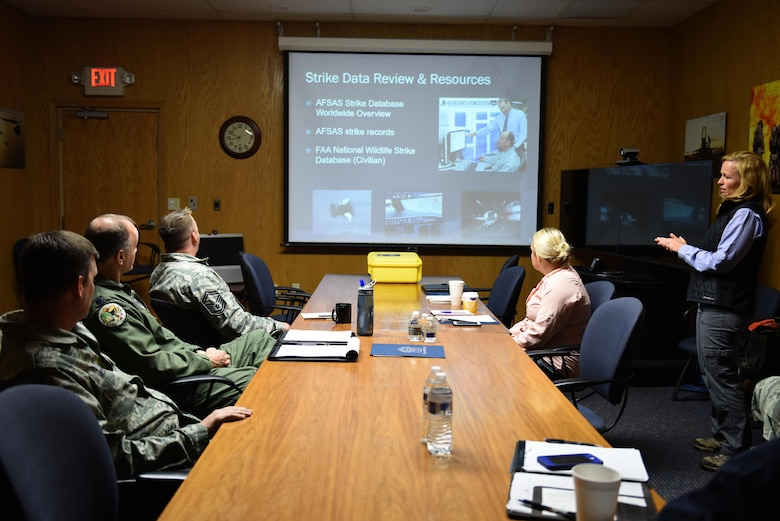 Director of Environmental Resource Solutions Southwest Florida Region and wildlife biologist, Sarah Brammell, assigned to the Air National Guard's Bird Aircraft Strike Hazard team, presents a briefing to members of the 180th Fighter Wing, Ohio Air National Guard, on the purpose of the BASH site visit, April 13, 2017. Wildlife-related incidents were documented as the leading cause of F-16 fighter jet mishaps in the first quarter of 2017. In an effort to mitigate impact to the mission and maximize the safety of pilots, aircraft and the abundant local-area wildlife, the 180FW, Ohio Air National Guard, hosted a Bird Aircraft Strike Hazard team visit to assess potential bird and other wildlife hazards located on and around the airfield at Toledo Express Airport in Swanton, Ohio. Ohio. Air National Guard Photo by Senior Master Sgt. Beth Holliker.