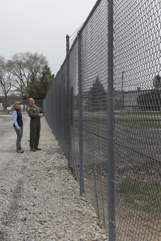 Director of Environmental Resource Solutions Southwest Florida Region and wildlife biologist, Sarah Brammell, assigned to the Air National Guard's Bird Aircraft Strike Hazard team, and Lt. Col. Scott Schaupeter, 180th Fighter Wing's director of ground and flying safety, evaluate the perimeter fencing around the 180FW airfield, April 13, 2017. Wildlife-related incidents were documented as the leading cause of F-16 fighter jet mishaps in the first quarter of 2017. In an effort to mitigate impact to the mission and maximize the safety of pilots, aircraft and the abundant local-area wildlife, the 180FW, Ohio Air National Guard, hosted a Bird Aircraft Strike Hazard team visit to assess potential bird and other wildlife hazards located on and around the airfield at Toledo Express Airport in Swanton, Ohio. Ohio. Air National Guard Photo by Senior Master Sgt. Beth Holliker.
