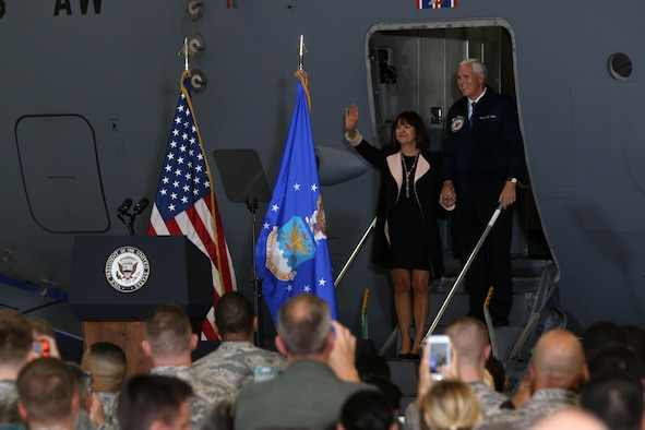 Vice President Mike Pence and his wife Karen wave to military members inside a 445th Airlift Wing hangar as they arrive to greet Airmen and their families, May 20, 2017 . The vice president visited Wright-Patterson Air Force Base to speak to approximately 250 Airmen and families to commemorate Armed Forces Day. (U.S. Air Force photo/Tech. Sgt. Patrick O'Reilly)