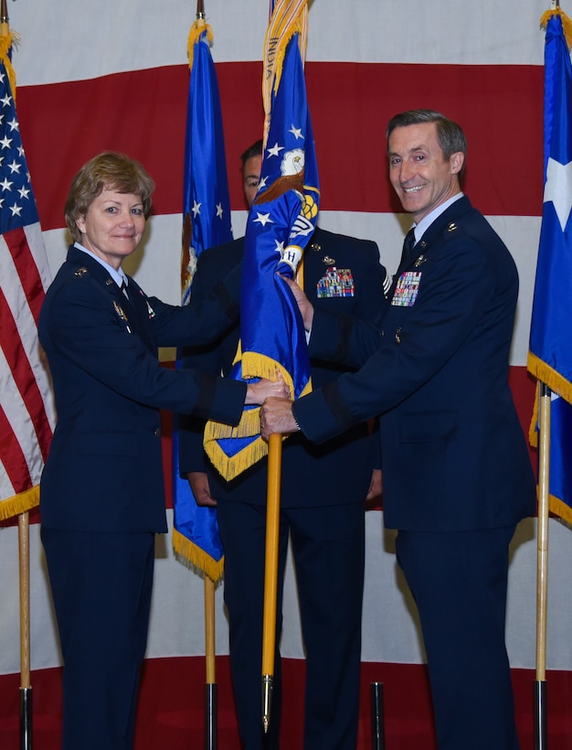 "Lt. Gen. Maryanne Miller, chief of Air Force Reserve and commander, Air Force Reserve Command, gives the Tenth Air Force guidon to Maj. Gen. Ronald B. ""Bruce"" Miller, during a change of command ceremony, May 17, 2017 at Naval Air Station Fort Worth Joint Reserve Base, Texas. This will be Miller's second time to command a unit here, his first was the 301st Fighter Wing from 2010-2013. (U.S. Air Force photo by Ms. Julie Briden-Garcia)"