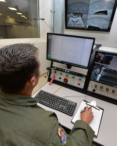 U.S. Air Force Tech. Sgt. Adam Tyler, USAF School of Aerospace Medicine operational physiology technician, enters preflight configurations for the school's Centrifuge from the control room as part of a training program at Wright-Patterson Air Force Base, Ohio, April 26, 2017.  The centrifuge simulates a high-G environment used for training and evaluating aircrew on a properly performed anti-G straining maneuver, in a controlled environment. (U.S. Air Force photo/Michelle Gigante)
