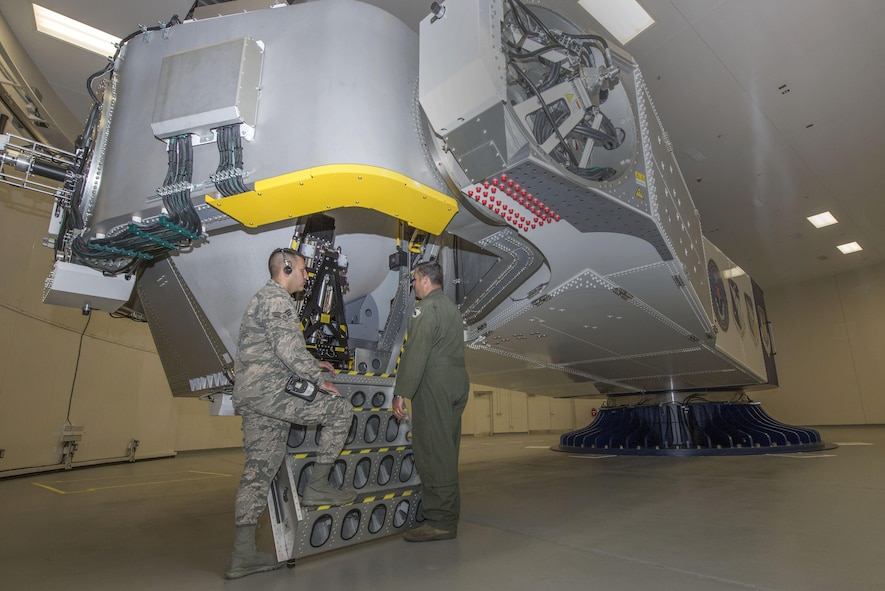 U.S. Air Force School of Aerospace Medicine operational physiology technicians, Senior Airman Luciano Cattaneo and Tech. Sgt. Adam Tyler, prepare to climb into the training centrifuge at Wright-Patterson Air Force Base, Ohio, April 26, 2017.  The purpose of the centrifuge is to provide optimum physical conditioning, appropriate functioning of anti-G equipment, and adequate G-oriented situational awareness for aircrew G-tolerance. (U.S. Air Force photo/Michelle Gigante)
