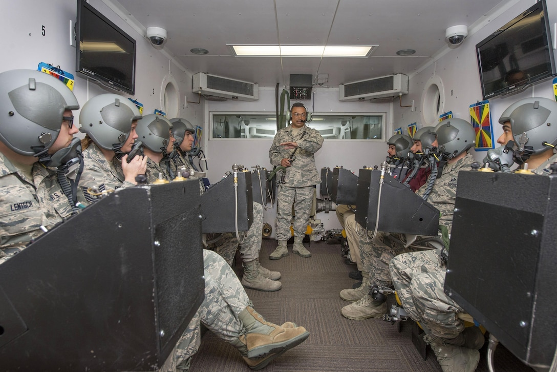 U.S. Air Force Senior Master Sgt. Paul Johal, School of Aerospace Medicine operational physiology superintendent, briefs students in the altitude hypobaric chamber about familiarizing themselves with the oxygen equipment for USAFSAM hypoxia demo training at Wright-Patterson Air Force Base, Ohio, April 26, 2017. The hypobaric chamber provides a training system which replicates the effects of barometric pressure change on the human body. (U.S. Air Force photo/Michelle Gigante)