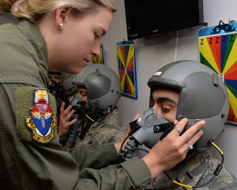 U.S. Air Force Senior Airman Darrian Caskey, School of Aerospace Medicine operational physiology technician, performs a seal check on the mask of 1st Lt. Alex Medina, USAFSAM student in the altitude hypobaric chamber for USAFSAM hypoxia demo training at Wright-Patterson Air Force Base, Ohio, April 26, 2017. The exposure to a low barometric pressure environment helps students recognize personal hypoxia symptoms as well as physical effects of pressure change at various training altitudes. (U.S. Air Force photo/Michelle Gigante)