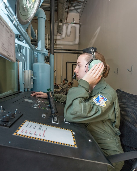 U.S. Air Force Airman 1st Class Jenna Dotson, USAF School of Aerospace Medicine operational physiology technician, monitors the altitude hypobaric chamber prior to the start of hypoxia demo training at Wright-Patterson Air Force Base, Ohio, April 26, 2017. The ability to simulate an aircraft rapid decompression provides valuable training experience for aircrew and parachutists. (U.S. Air Force photo/Michelle Gigante)