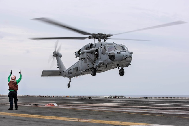 A Navy MH-60S Sea Hawk helicopter takes off from the flight deck of the aircraft carrier USS Ronald Reagan in the waters south of Japan, May 17, 2017. The helicopter crew is assigned to Helicopter Sea Combat Squadron 12. Ronald Reagan is the flagship of Carrier Strike Group 5, providing a combat-ready force that protects and defends the collective maritime interests of its allies and partners in the Indo-Asia-Pacific region. Navy photo by Petty Officer 2nd Class Nathan Burke