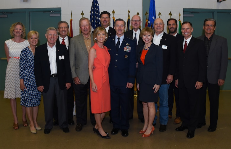 "Maj. Gen. Ronald B. ""Bruce"" Miller, the new Tenth Air Force commander, poses with his wife and civic leaders after a change of command ceremony, May 17, 2017 at Naval Air Station Fort Worth Joint Reserve Base, Texas. This will be Miller's second time commanding a unit here, his first was as the 301st Fighter Wing Commander from 2010-2013. (U.S. Air Force photo by Ms. Julie Briden-Garcia)"