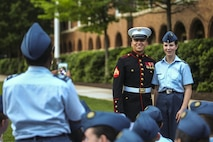 Cpl. Fernando Maldonado, crowd educator with Marine Barracks Washington D.C., takes a photo with a Junior Reserve Officer Training Corps member during a Friday Evening Parade at the Barracks, May 19, 2017. The guest of honor for the parade was Secretary of Homeland Security, John F. Kelly, and the hosting official was Commandant of the Marine Corps Gen. Robert B. Neller. (Official Marine Corps photo by Lance Cpl. Damon Mclean/Released)
