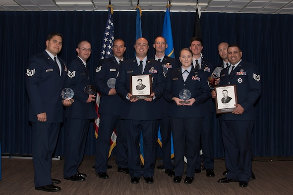 PETERSON AIR FORCE BASE, Colo. – Forrest L. Vosler NCO Academy class 17-5 students graduate with academic or distinguished awards at The Club, May 19, 2017, at Peterson Air Force Base, Colo. The NCOs completed 25 academic days covering multiple training tasks on self-improvement, adaptability, effective negotiations and leadership. The class also volunteered a total of 241 hours throughout the community on top of their academic studies. (U.S. Air Force photo by Staff Sgt. Tiffany Lundberg)