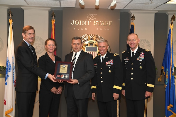 Karl F. Schneider (Left), senior career official performing the duties of the Under Secretary of the Army, host of the 2016 Lean Six Sigma excellence awards program ceremony May 18, 2017 at the Pentagon in Arlington, Va., poses with Diane Parks (Second from left), U.S. Army Corps of Engineers Nashville District chief of Operations, Tim Dunn (Third from left), Nashville District deputy chief of Operations, and Maj. Gen. Richard L. Stevens, (Fourth from left) U.S. Army Corps of Engineers deputy commanding general, and Lt. Gen. Edward C. Cardon, director of the Office of Business Transformation. Parks and Dunn accepted the Army's Lean Six Sigma Award Program Process Improvement Project Team Excellence Award. (U.S. Army photo by Leroy Council)
