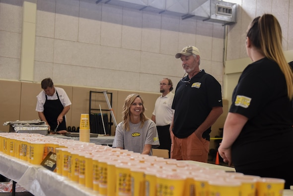 Volunteers distribute drinks for Goodfellow members for Goodfellow Appreciation Day at the Carswell Field House on Goodfellow Air Force Base, Texas, May 20, 2017. The event was catered by various San Angelo restaurants. (U.S. Air Force photo by Airman 1st Class Chase Sousa/Released)