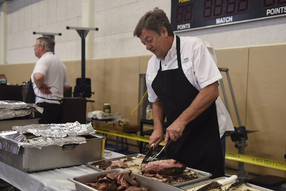 Brisket is prepared by volunteers at the Carswell Field House on Goodfellow Air Force Base, Texas, May 20, 2017. Food and admission were offered free to all Team Goodfellow members. (U.S. Air Force photo by Airman 1st Class Chase Sousa/Released)
