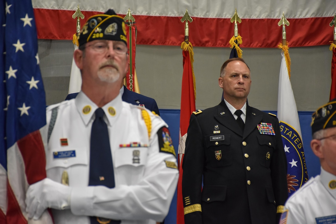 """Fort McCoy Senior Commander and 88th Regional Support Command Commanding General, Maj. Gen. Patrick Reinert stands at attention while the American Legion Post 288 out of Cedarburg, Wis., provides color guard support during an """"Our Community Salutes"""" event at Fort McCoy, Wisconsin on Armed Forces Day, May 20, 2017."""