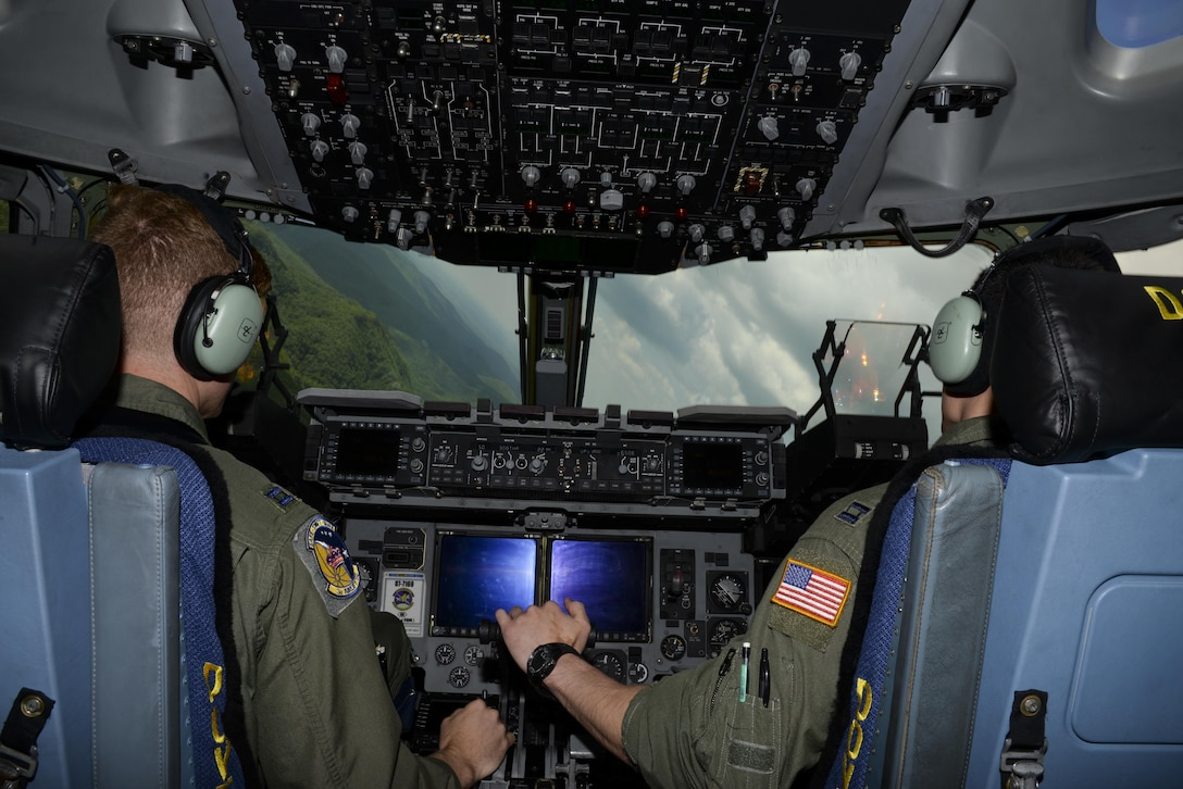 Capts. Ryan Nichol and Jeff Hogan, 3d Airlift Squadron pilots, perform low-level maneuvers May 15, 2017, aboard a C-17 Globemaster III over the Appalachian Mountains. Nichol and Hogan practiced precision flying as they headed to Moody Air Force Base, Ga., in preparation for Exercise RAPID RESCUE. (U.S. Air Force Photo by Senior Airman Aaron J. Jenne)