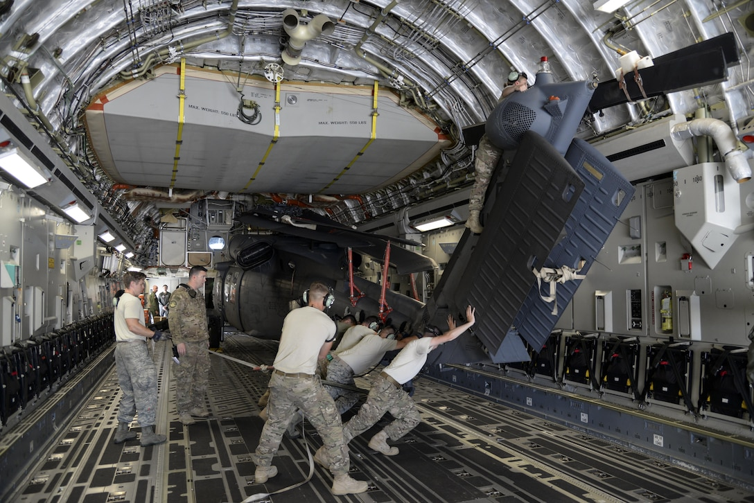 Members of the 723d Aircraft Maintenance Squadron, 41st Helicopter Maintenance Unit assigned to Moody Air Force Base, Ga., position an HH-60G Pave Hawk search and rescue helicopter May 15, 2017, on a 3d Airlift Squadron C-17 Globemaster III at Moody AFB. The maintainers loaded two HH-60 aircraft, which were flown to Langley Air Force Base, Va., for Exercise Rapid Rescue on May 17. (U.S. Air Force Photo by Senior Airman Aaron J. Jenne)