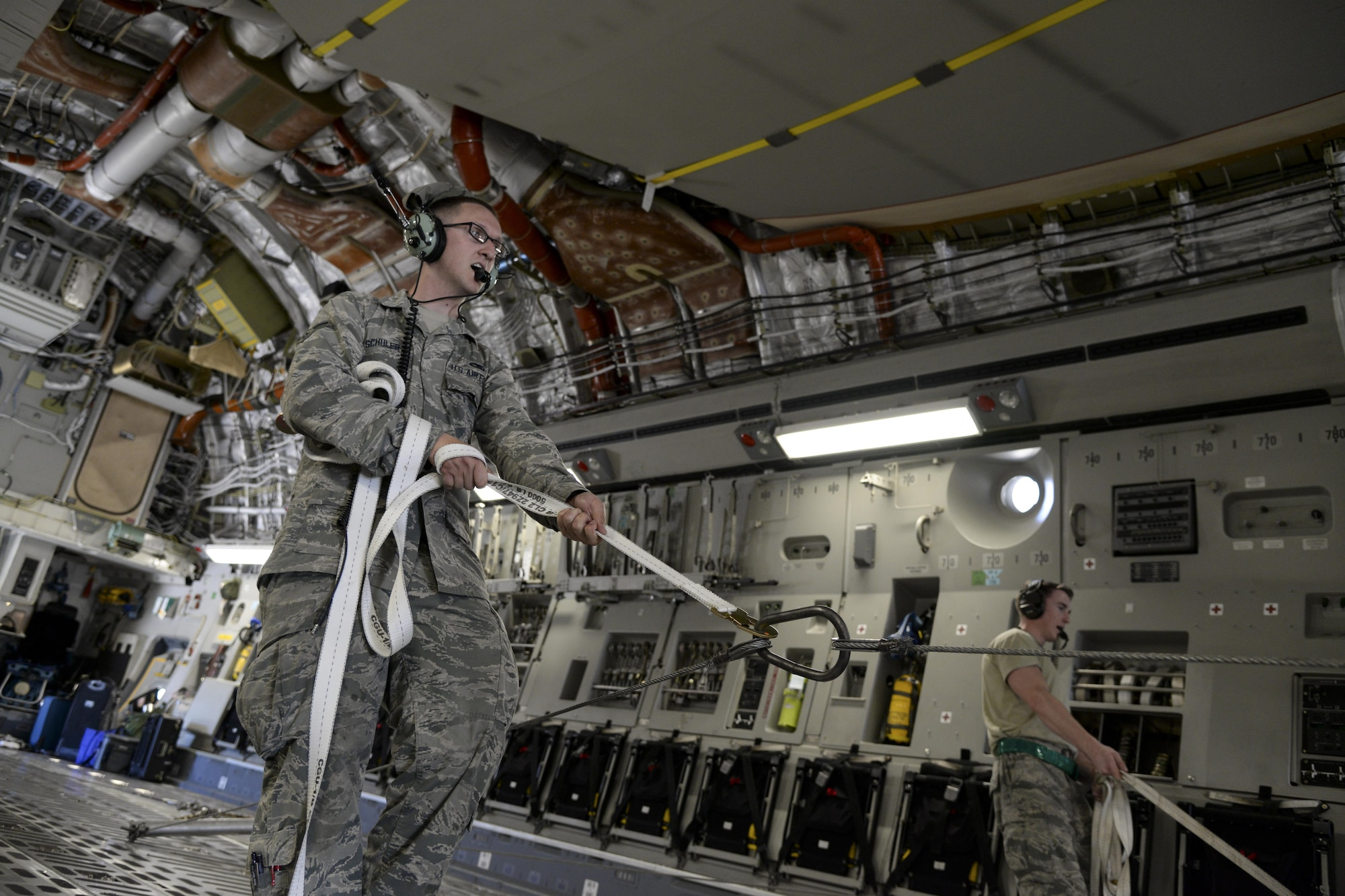 Airman 1st Class Isaac Schuler, 723d Aircraft Maintenance Squadron, 41st Helicopter Maintenance Unit electronic warfare technician assigned to Moody Air Force Base, Ga., guides an HH-60G Pave Hawk search and rescue helicopter May 16, 2017, as it is offloaded from a 3d Airlift Squadron C-17 Globemaster III at Langley Air Force Base, Va. The Airmen worked in unison to ensure the helicopter was safely off-loaded. (U.S. Air Force photo by Senior Airman Aaron J. Jenne)