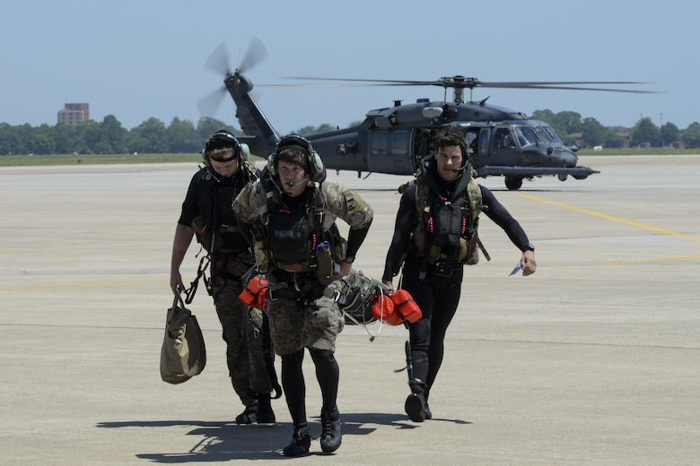From left, Staff Sgt. Robert Hall, Staff Sgt. Travis Lester, and Senior Airman Eddie Judge, 38th Rescue Squadron pararescuemen assigned to Moody Air Force Base, Ga., carry an Airman with simulated injuries toward a 3d Airlift Squadron C-17 Globemaster III May 17, 2017, during Exercise RAPID RESCUE at Langley AFB, Va. The C-17 was prepped and ready to takeoff for a simulated aeromedical evacuation flight when the search and rescue team arrived. (U.S. Air Force photo by Senior Airman Aaron J. Jenne)