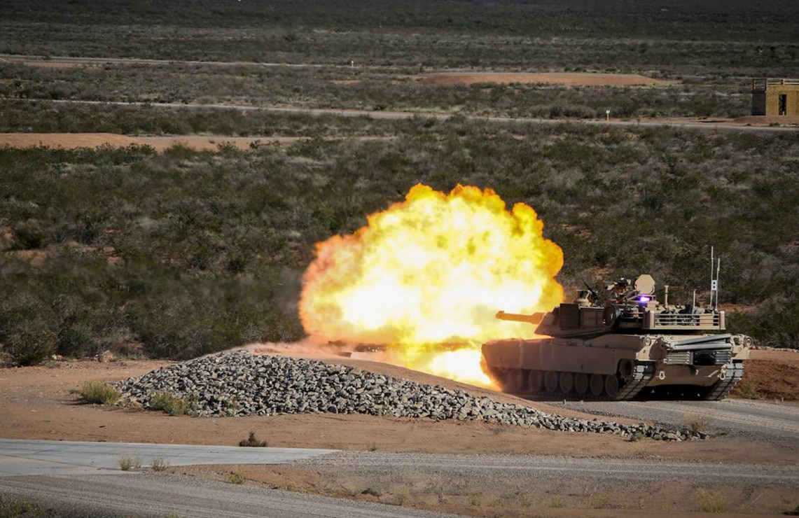 An M1A1 Abram tank fires at the Fort Bliss, Texas, Digital Multipurpose Range Complex in 2012. The Range and Training Land Program Mandatory Center of Expertise has been involved in standardizing ranges since fiscal year 1984 with the design and construction of three multi-purpose range complexes and 10 infantry ranges at various installations that year. The RTLP MCX has since been involved in the design and construction of hundreds of ranges and training facilities, including Fort Bliss.