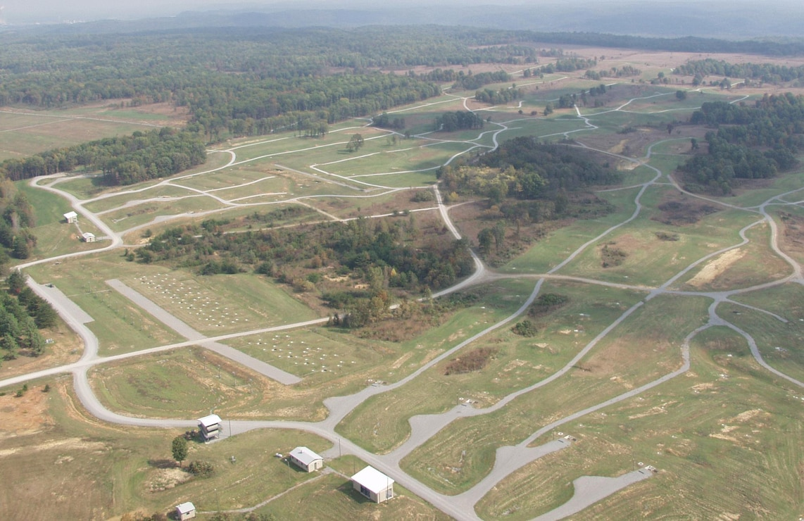 An arial view of the Qualification Training Range at Fort Knox, Kentucky. The road network servicing the training complex is a key support element of the training mission. The U.S. Army Engineering and Support Center, Huntsville is the designated the Range and Training Land Program Mandatory Center of Expertise and develops generic design manuals for Multi-Purpose Range Complexes