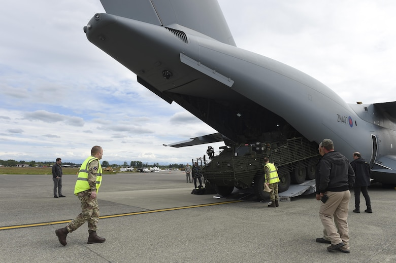 A Stryker vehicle is nearly loaded onto a Royal Air Force A-400M aircraft by the 1st Stryker Brigade Combat Team Soldiers on the McChord Field flightline on May 18, 2017, at Joint Base Lewis-McChord, Wash. The RAF will be one of dozens of international militaries participating in the Mobility Guardian exercise during which JBLM will serve as the primary hub for operations. (U.S. Air Force Photo/ Staff Sgt. Naomi Shipley)
