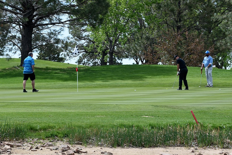 PETERSON AIR FORCE BASE, Colo. – Airmen from the 21st Security Forces Squadron and 21st Civil Engineer Squadron, putt on the 17th green during the National Police Week golf tournament at Silver Spruce golf course, May 17, 2017, Peterson Air Force Base, Colo. The 21st SFS hosted local law enforcement officers and Team Pete Airmen for several events throughout the week including an obstacle course, BBQ and combative event. (U.S. Air Force photo by Robb Lingley)