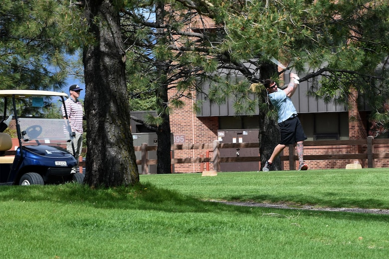 PETERSON AIR FORCE BASE, Colo. – Airmen from the 21st Security Forces Squadron and 21st Civil Engineer Squadron, tee off at the 18th tee box during the National Police Week golf tournament at Silver Spruce golf course, May 17, 2017, Peterson Air Force Base, Colo. Established in 1962 as a joint resolution in Congress, National Police Week recognizes law enforcement officers who have lost their lives in the line of duty. (U.S. Air Force photo by Robb Lingley)