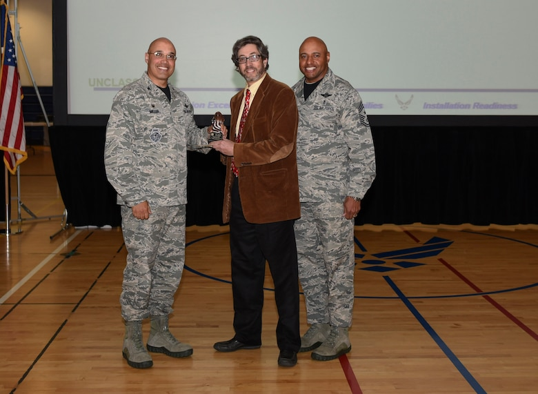 Ronn Greengas, 460th Force Support Squadron unit program coordinator, receives the Category I Non-Supervisory Civilian of the Quarter Award May 19, 2017, on Buckley Air Force Base, Colo.  Awards were given to the Team Buckley members who showed dedication, hard work and exceeded their supervisor's expectations. (U.S. Air Force photo by Airman 1st Class Holden S. Faul/ Released)
