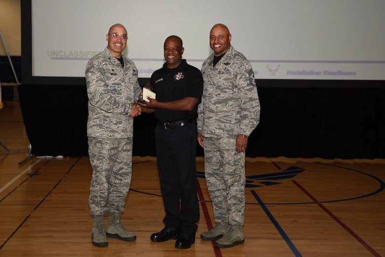 Andre Sanders, 460th Civil Engineer Squadron assistant chief of health and safety, receives the Category II Non-Supervisory Civilian of the Quarter Award May 19, 2017, on Buckley Air Force Base, Colo.  Awards were given to the Team Buckley members who showed dedication, hard work and exceeded their supervisor's expectations. (U.S. Air Force photo by Airman 1st Class Holden S. Faul/ Released)