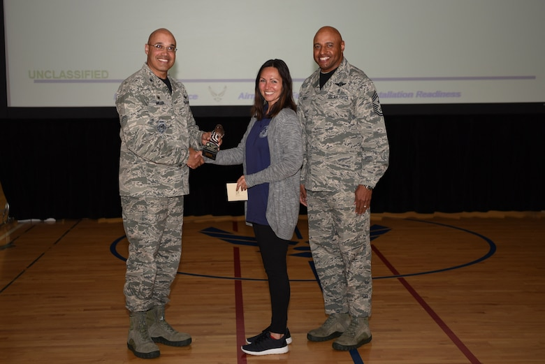 Candice Ruggles, 460th Force Support Squadron lead program technician, receives the Category I Supervisory Civilian of the Quarter Award May 19, 2017, on Buckley Air Force Base, Colo.  Awards were given to the Team Buckley members who showed dedication, hard work and exceeded their supervisor's expectations. (U.S. Air Force photo by Airman 1st Class Holden S. Faul/ Released)