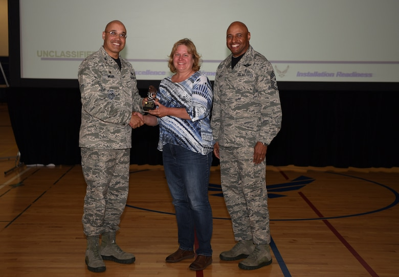 Judy Corizzo, 460th Comptroller Squadron budget officer, receives the Category II Supervisory Civilian of the Quarter Award May 19, 2017, on Buckley Air Force Base, Colo.  Awards were given to the Team Buckley members who showed dedication, hard work and exceeded their supervisor's expectations. (U.S. Air Force photo by Airman 1st Class Holden S. Faul/ released)