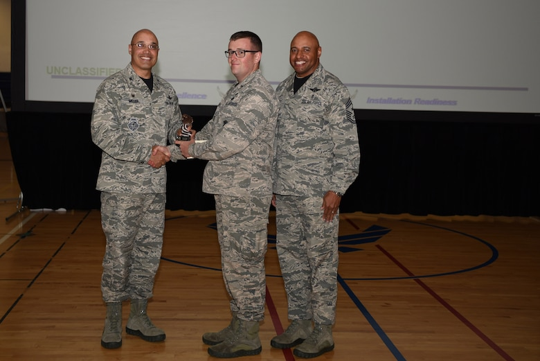 1st Lt. Conor Melanson, 460th Security Forces Squadron operations officer, receives the Company Grade Officer of the Quarter Award May 19, 2017, on Buckley Air Force Base, Colo.  Awards were given to the Team Buckley members who showed dedication, hard work and exceeded their supervisor's expectations. (U.S. Air Force photo by Airman 1st Class Holden S. Faul/ released)